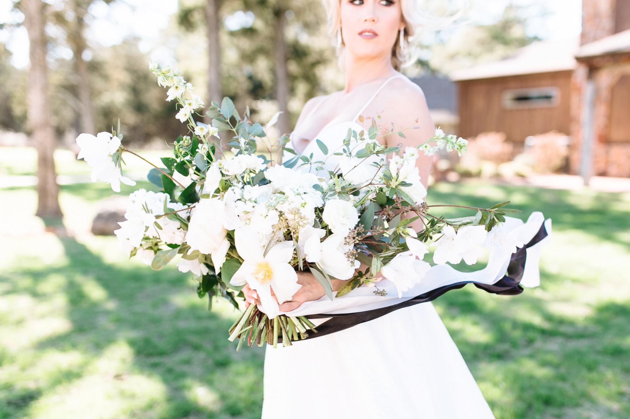 large bridal bouquet with white flowers by maxit flower design in houston texas