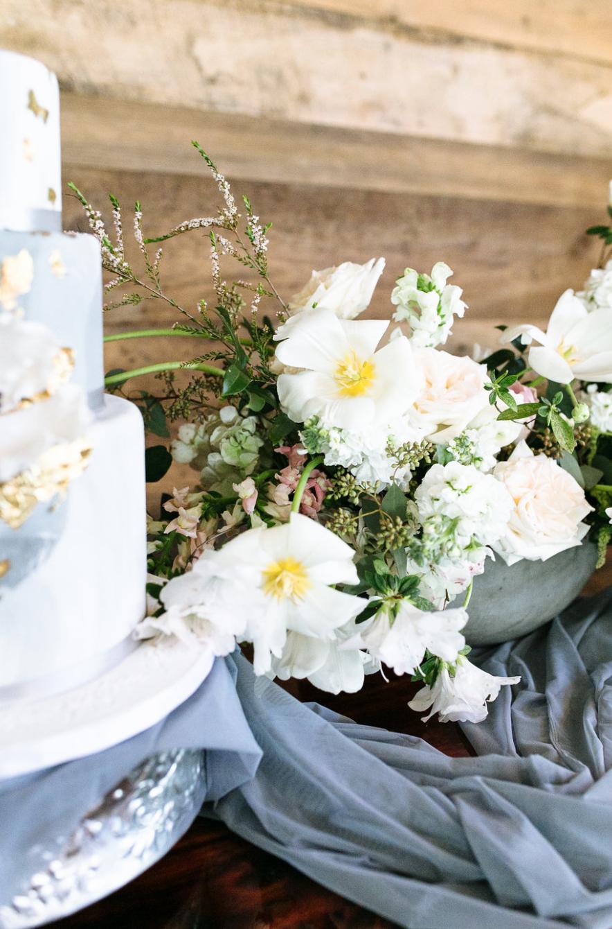 small flower arrangement by wedding cake by maxit flower design in houston texas