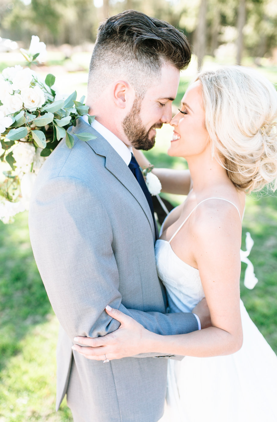 couple kissing after wedding florals by maxit flower design in houston texas