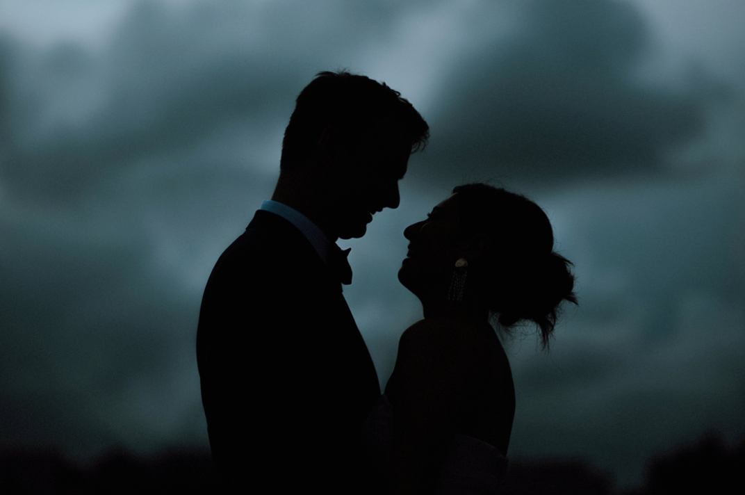 bride-groom-night-clouds-centennial-gardens-modern-wedding-moody-photography-joseph-west-maxit-flower-design-in-houston-texas