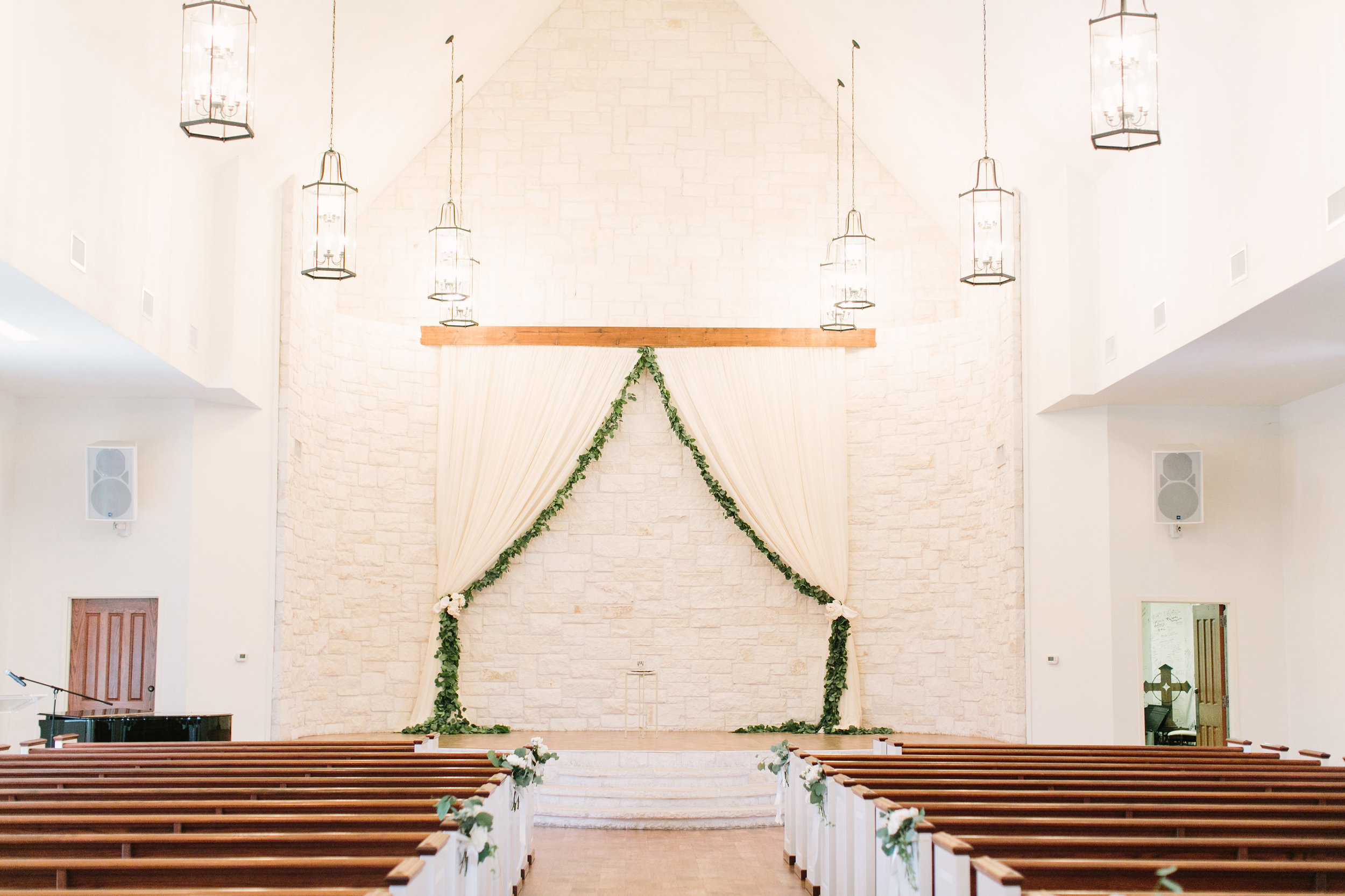 briscoe-manor-ceremony-altar-drapery-garland-greenery-white-floral-by-maxit-flower-design-in-houston-texas