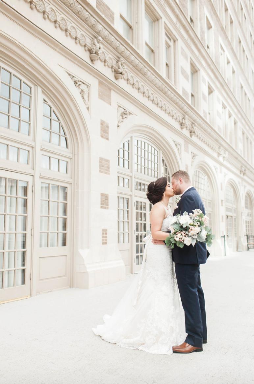 bride-goom-crystal-ballroom-airy-wedding-kiss-floral-by-maxit-flower-design-in-houston-texas
