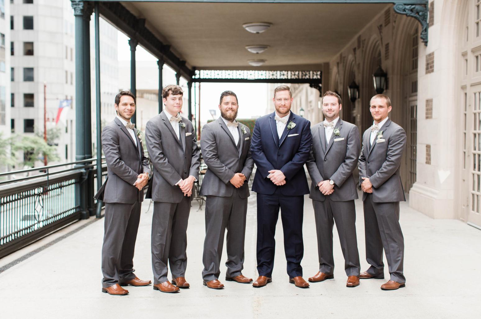 groom-groomsmen-boutonniere-navy-grey-suit-crystal-ballroom-wedding-florals-by-maxit-flower-design-in-houston-texas