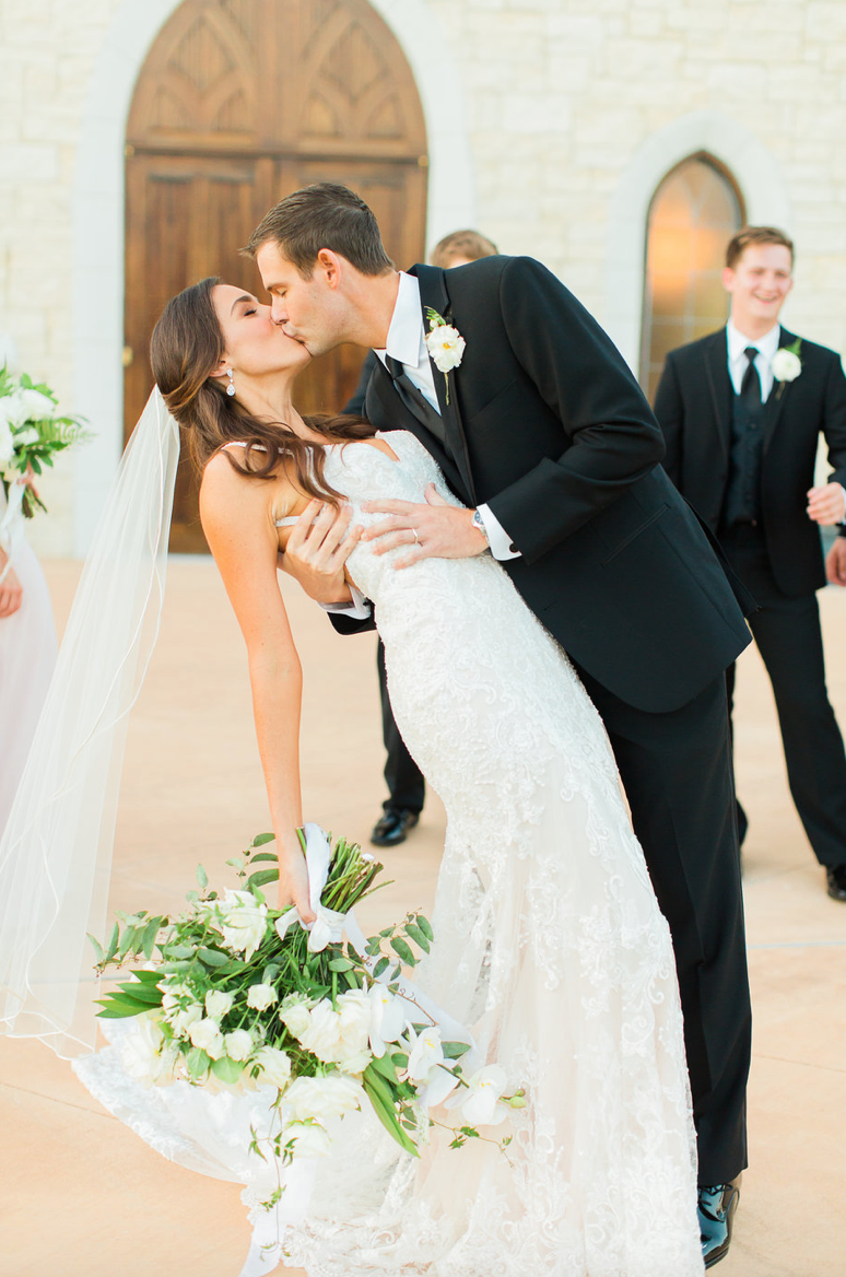 kiss-wedding-dip-groom-bride-bouquet-white-greenery-ribbon-florals-by-maxit-flower-design-in-houston-texas
