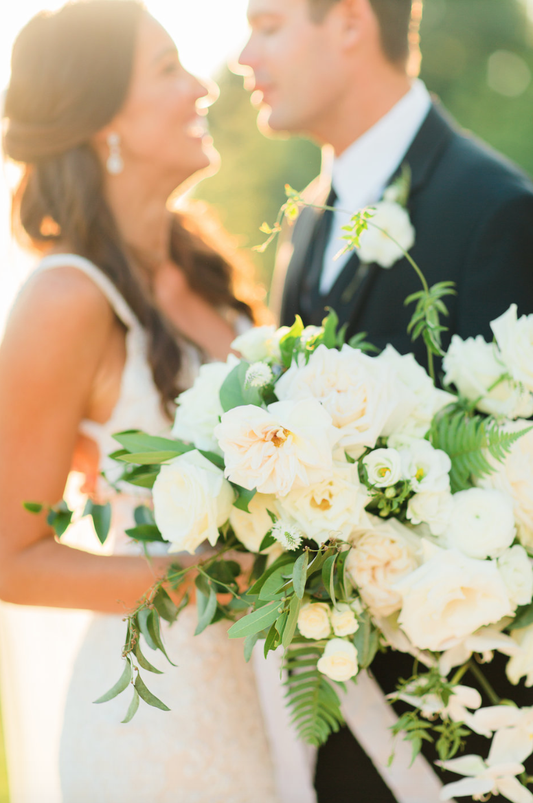 groom-sunlight-wedding-photography-bride-bouquet-white-greenery-ribbon-florals-by-maxit-flower-design-in-houston-texas