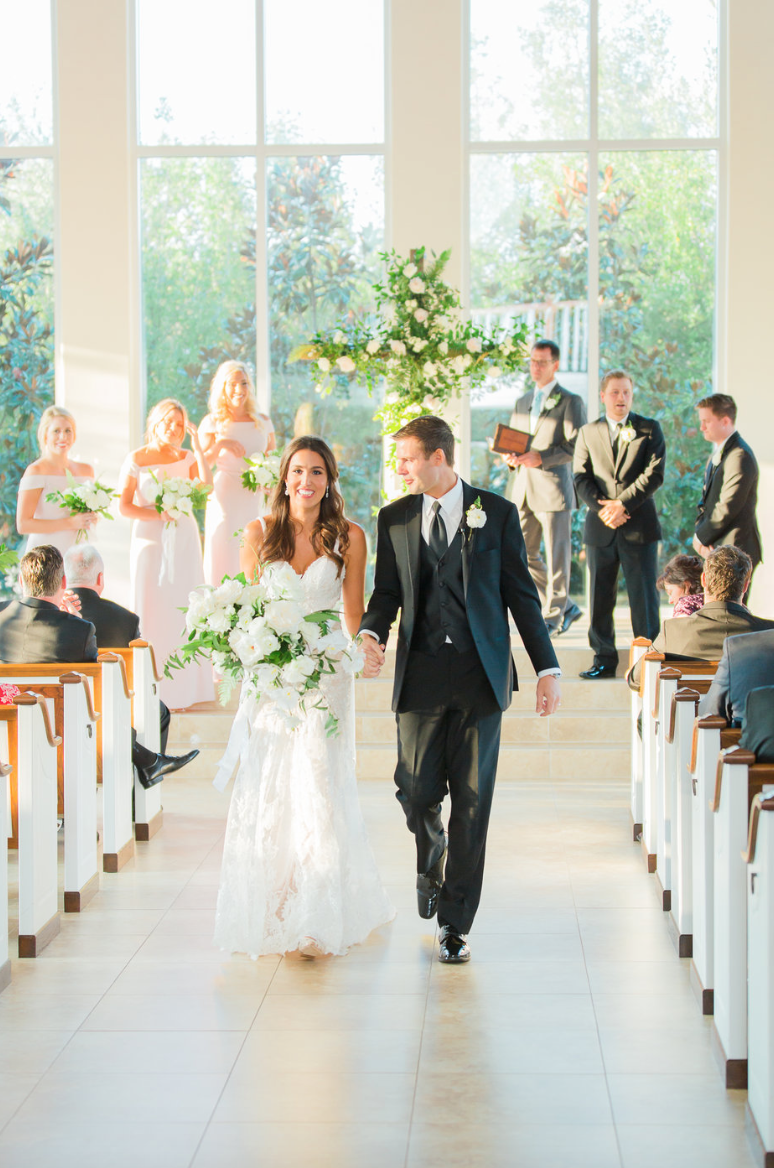 wedding-ceremony-cross-groom-bride-bouquet-white-greenery-ribbon-florals-by-maxit-flower-design-in-houston-texas