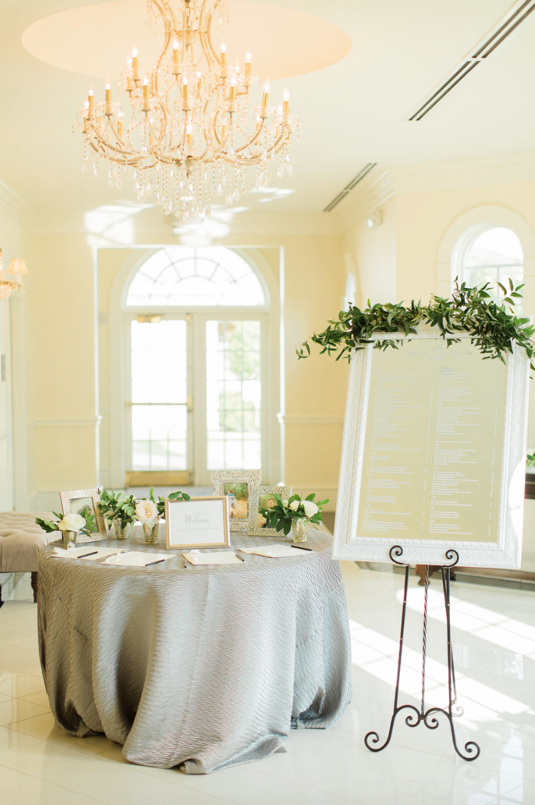 welcome-table-escort-mirror-garland-wedding-reception-white-greenery-ribbon-florals-by-maxit-flower-design-in-houston-texas