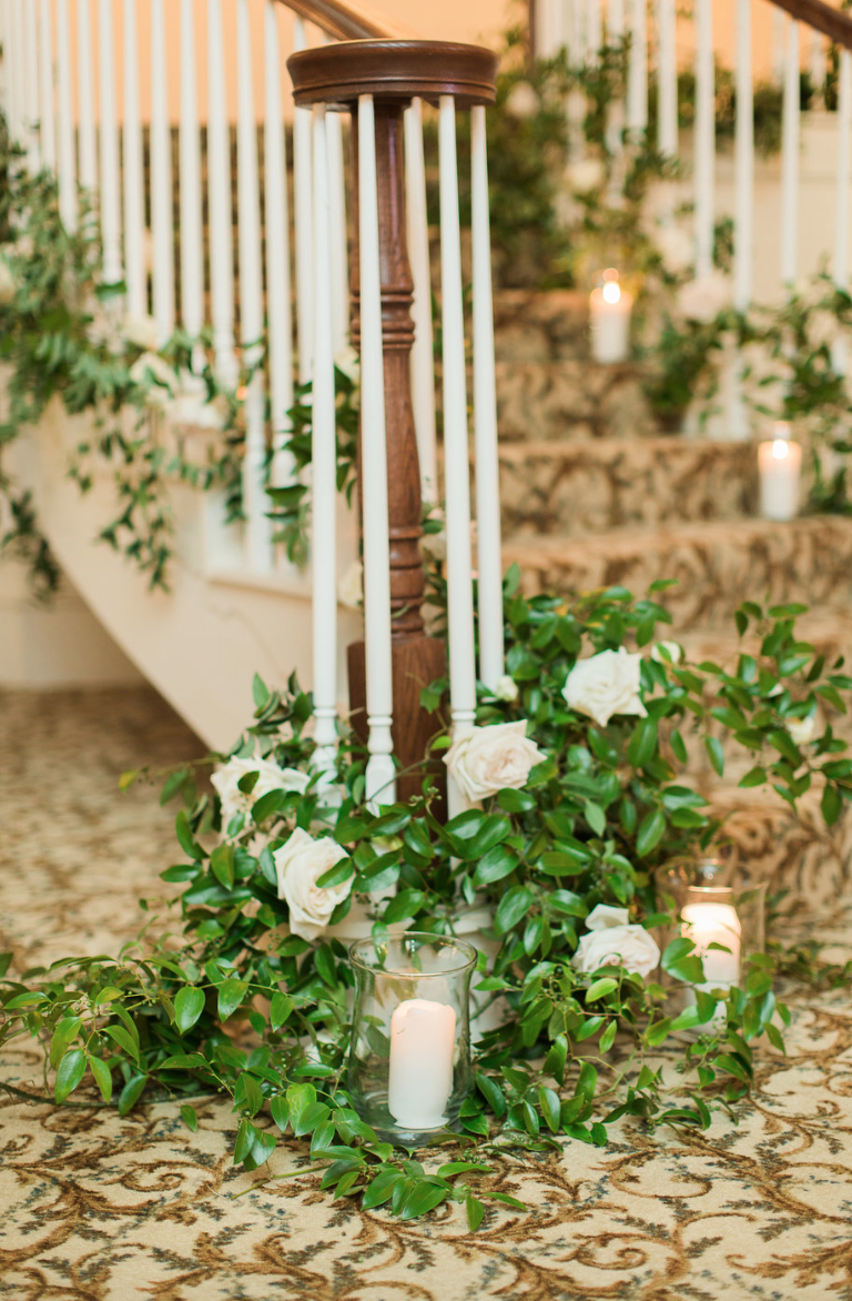 reception-staircase-garden-rose-candle-white-greenery-ribbon-florals-by-maxit-flower-design-in-houston-texas