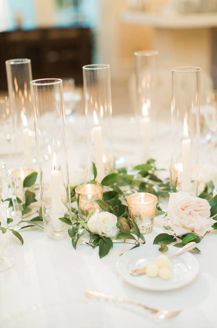 taper-candle-hurricane-glass-rose-white-greenery-ribbon-florals-by-maxit-flower-design-in-houston-texas