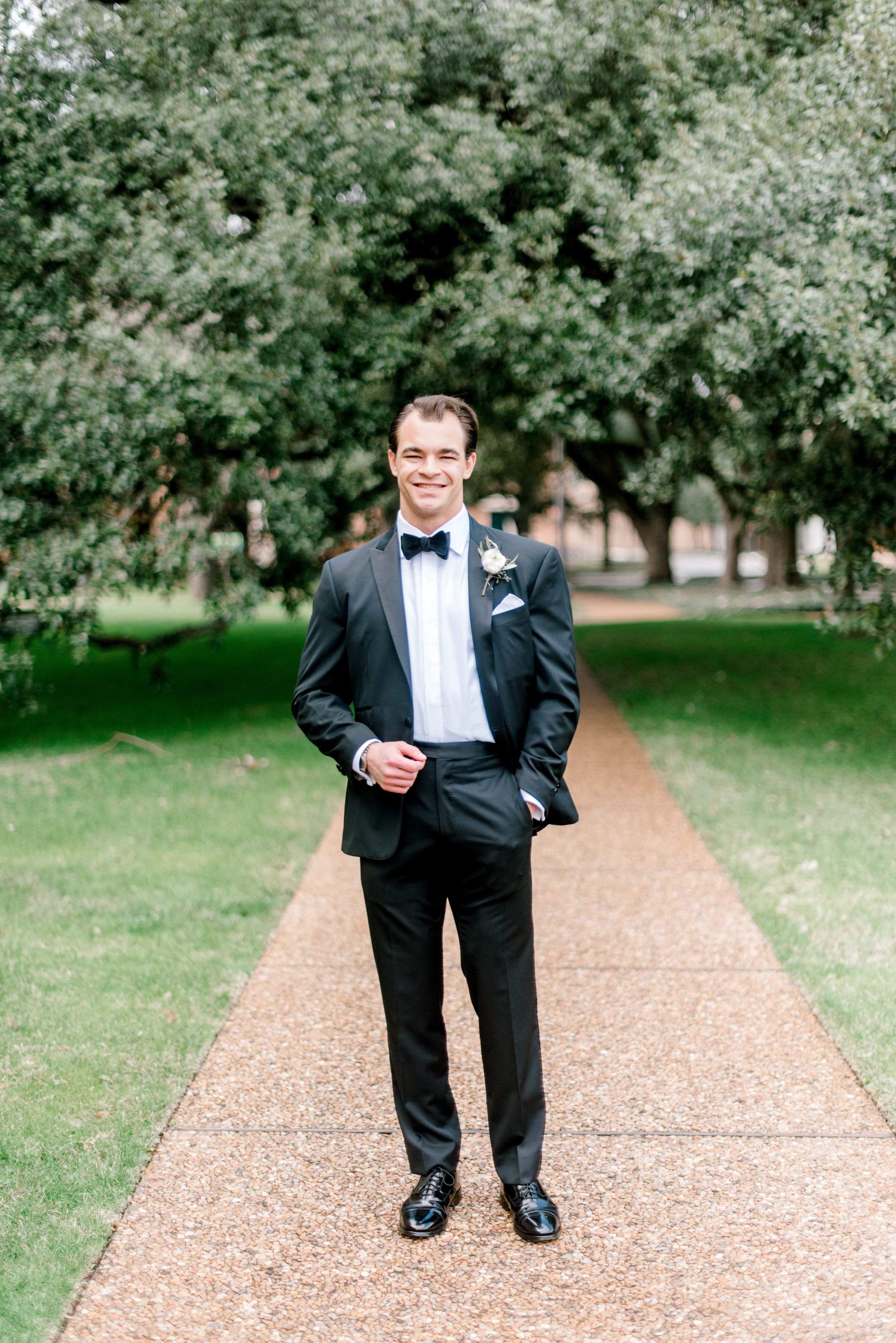 wedding-details-photography-dana-fernandez-groom-tux-bowtie-black-boutonniere-floral-greenery-by-maxit-flower-design-houston-texas
