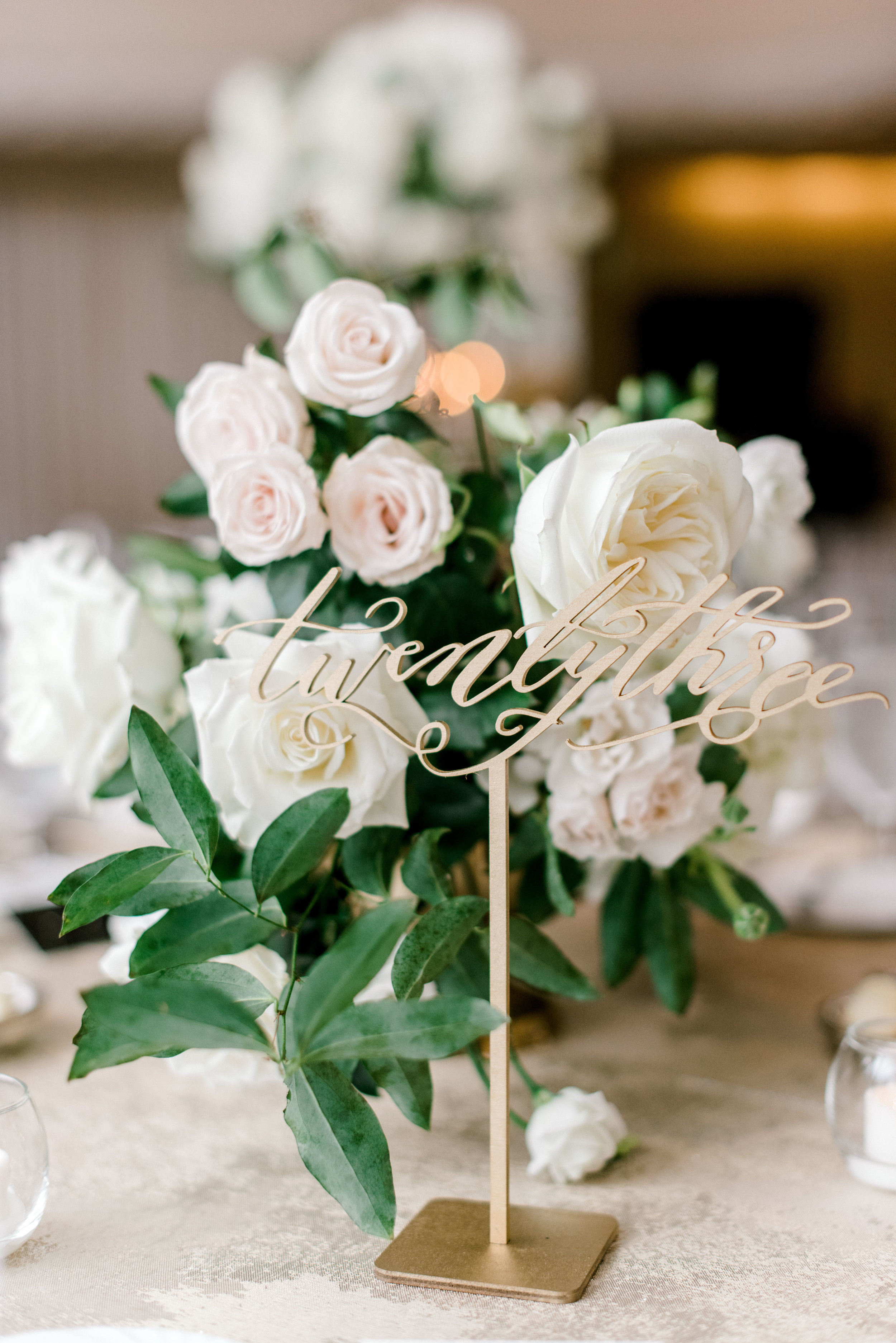 wedding-details-photography-dana-fernandez-reception-four-seasons-rose-white-blush-gold-calligraphy-table-number-floral-greenery-by-maxit-flower-design-houston-texas