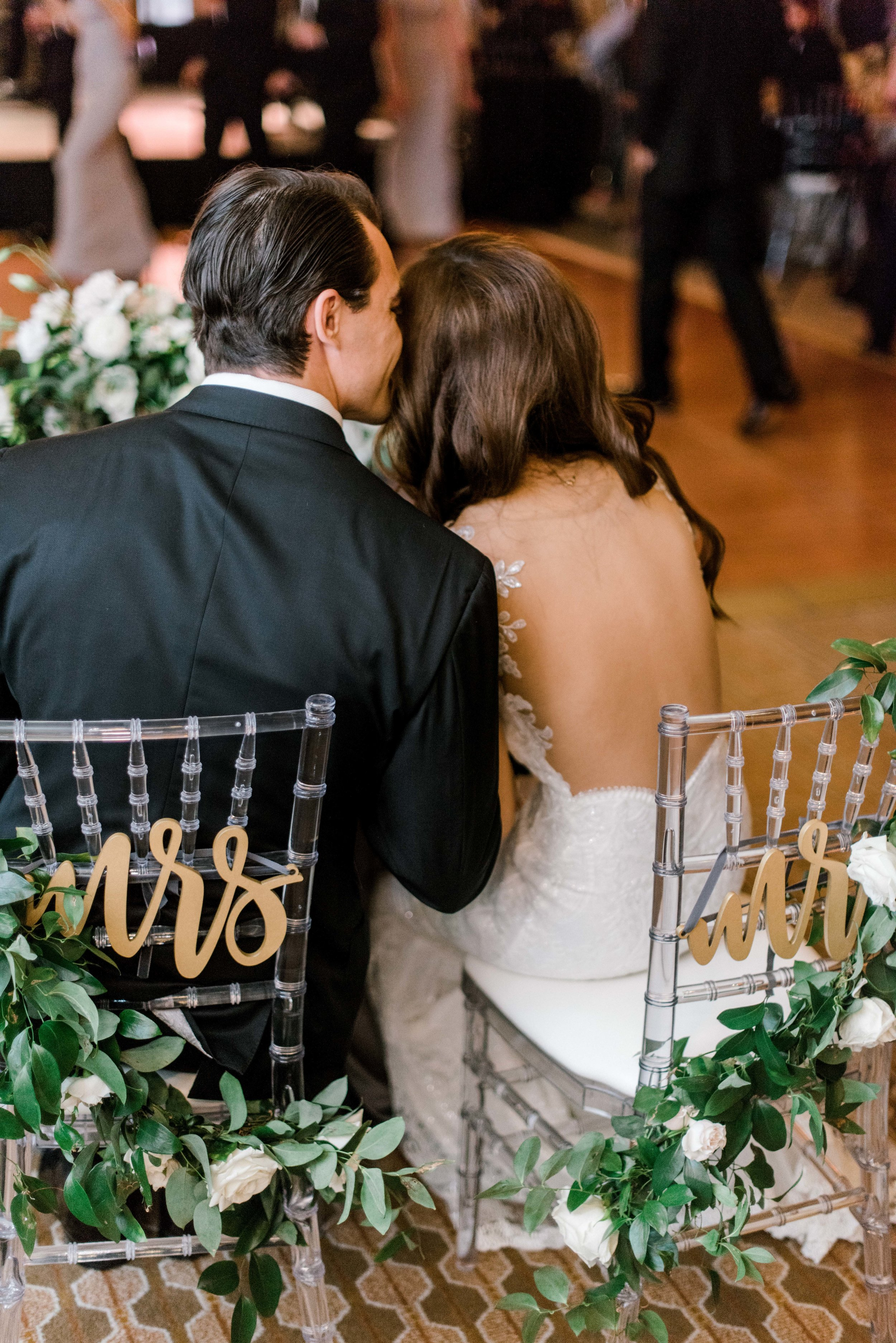 wedding-details-photography-dana-fernandez-reception-four-seasons-mr-mrs-chairs-calligraphy-garland-sweetheart-table-rose-white-blush-floral-greenery-by-maxit-flower-design-houston-texas
