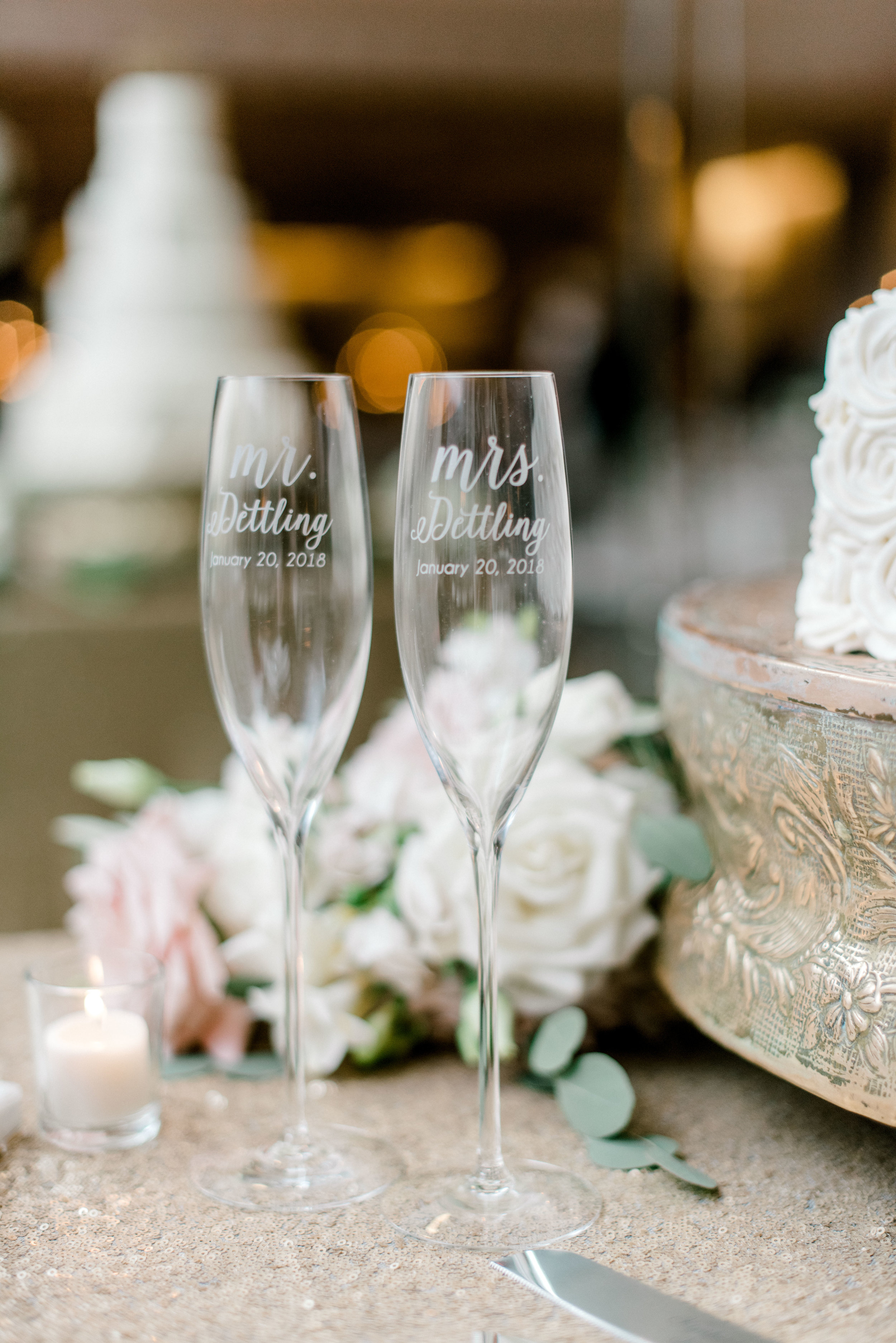 wedding-details-photography-dana-fernandez-reception-four-seasons-champagne-cake-toast-rose-white-blush-floral-greenery-by-maxit-flower-design-houston-texas