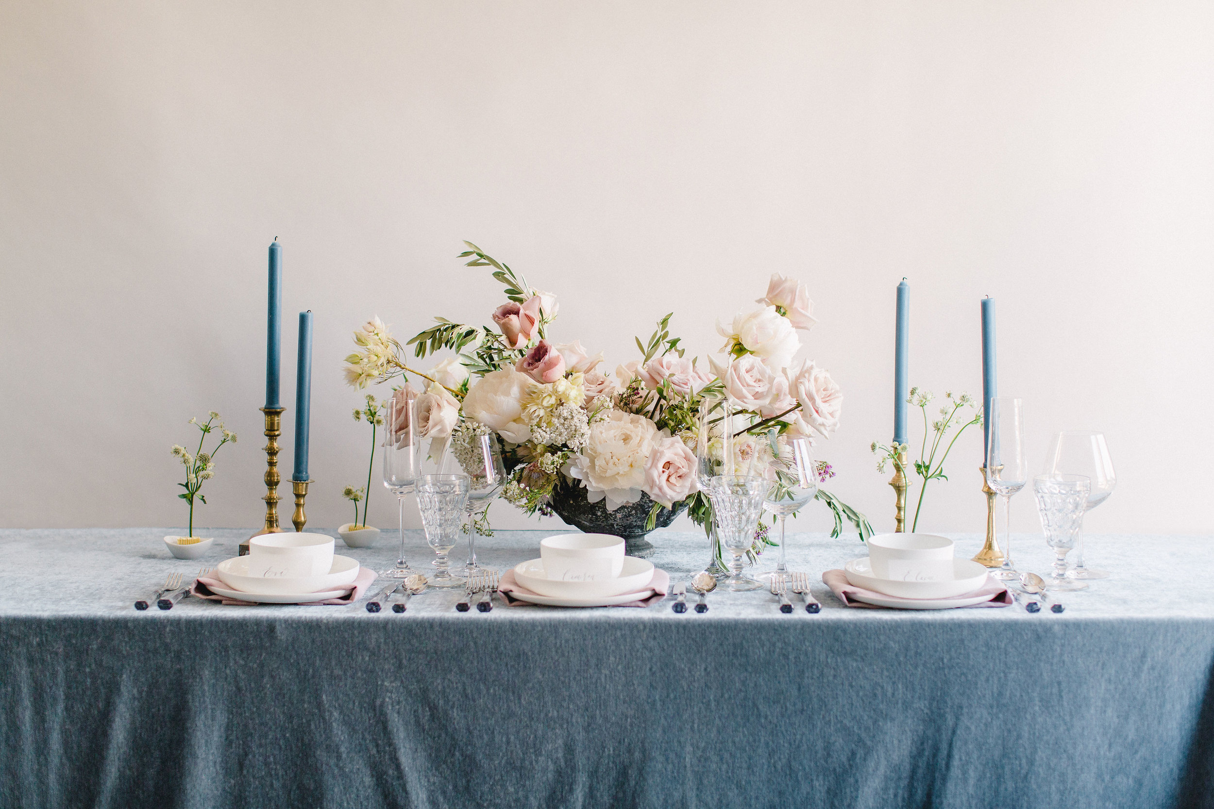 French blue and soft blush color palate combination. French blue taper candles and floral frogs as accents. Houston, TX. Floral & Design by Maxit Flower Design, Photography:  Alicia Yarrish