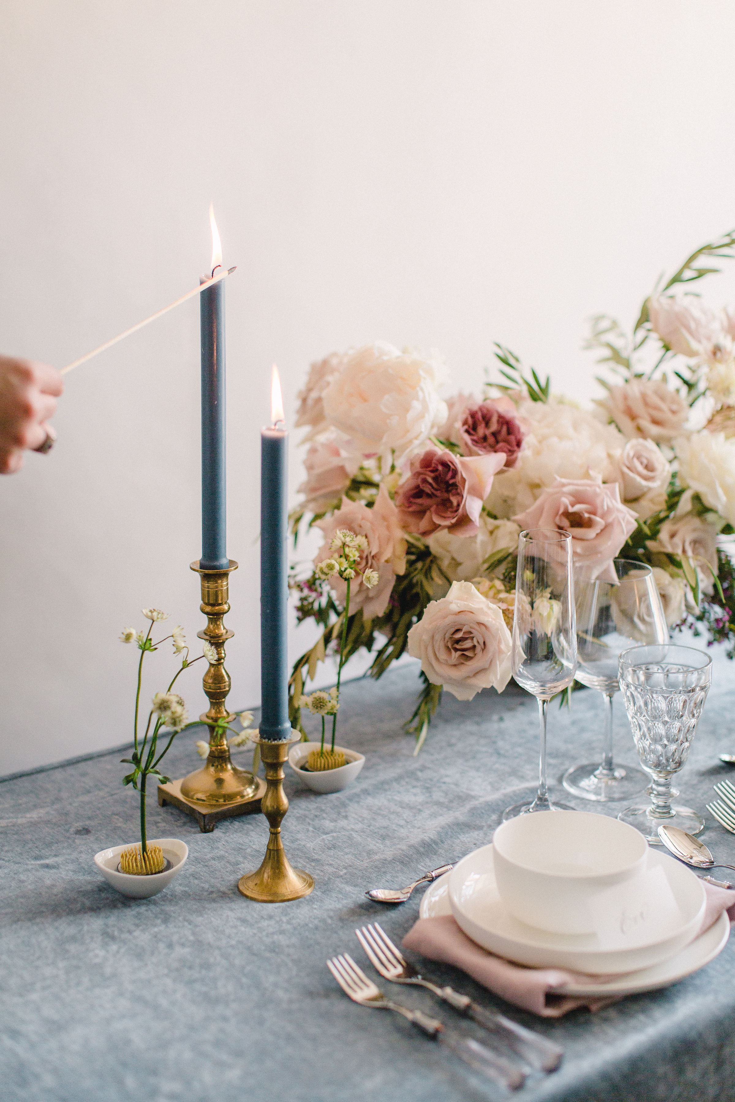 Taper candles and floral frogs make for a romantic table setting. Houston, TX. Floral & Event Design by Maxit Flower Design, Photography:  Alicia Yarrish