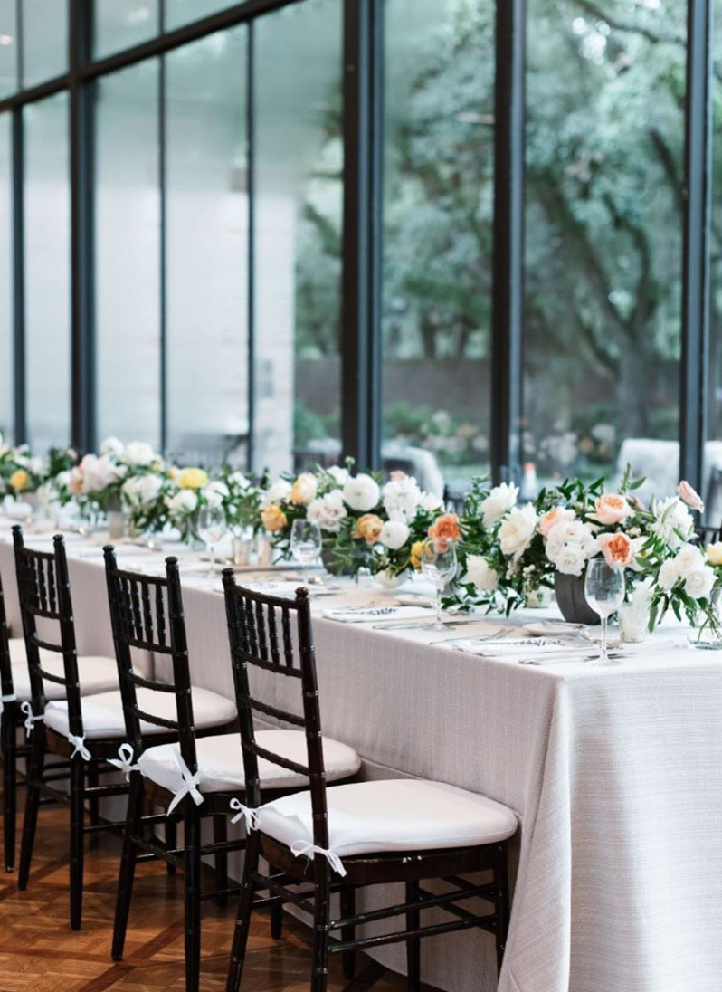 Modern head table with cement containers and garden style arrangements. Yellow, white and blush colored flowers with a touch of jasmine. Houston, Texas wedding in Rice University, Cohen House. Photographed by Josh & Dana Fernandez