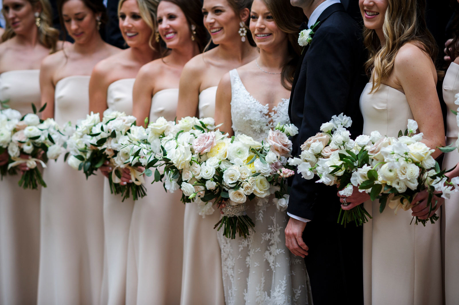 Bride with bridesmaids and groom. Blush, white and green bouquets in a lush garden style. Houston, Texas. Maxit Flower Design,  Alyssa Meeks  ,  Chris Bailey Photography