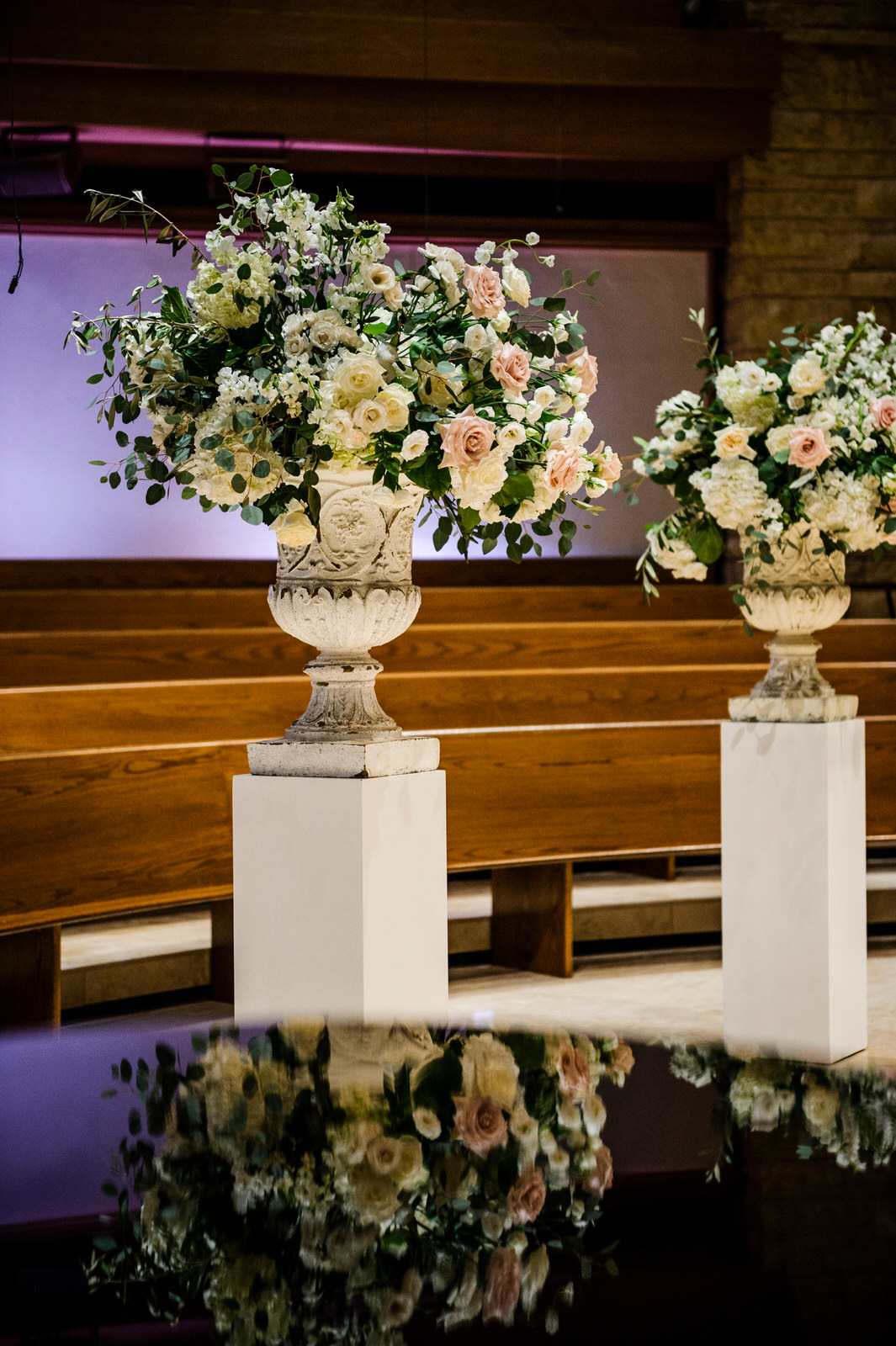 Altar arrangements, blush, white, garden style urn. White pedestals. Wedding ceremony in  Memorial Drive Presbyterian , Houston, Texas. Maxit Flower Design,  Alyssa Meeks  ,  Chris Bailey Photography