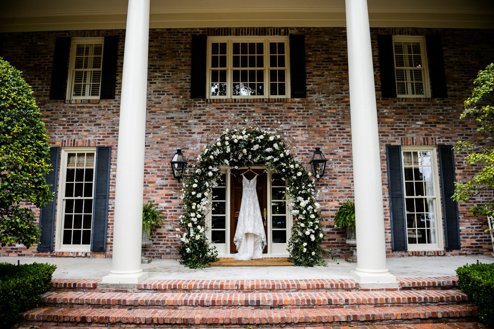 Floral arch entry with all white flowers and greenery. Private residence in Houston, Texas. Maxit Flower Design,  Alyssa Meeks  ,  Chris Bailey Photography