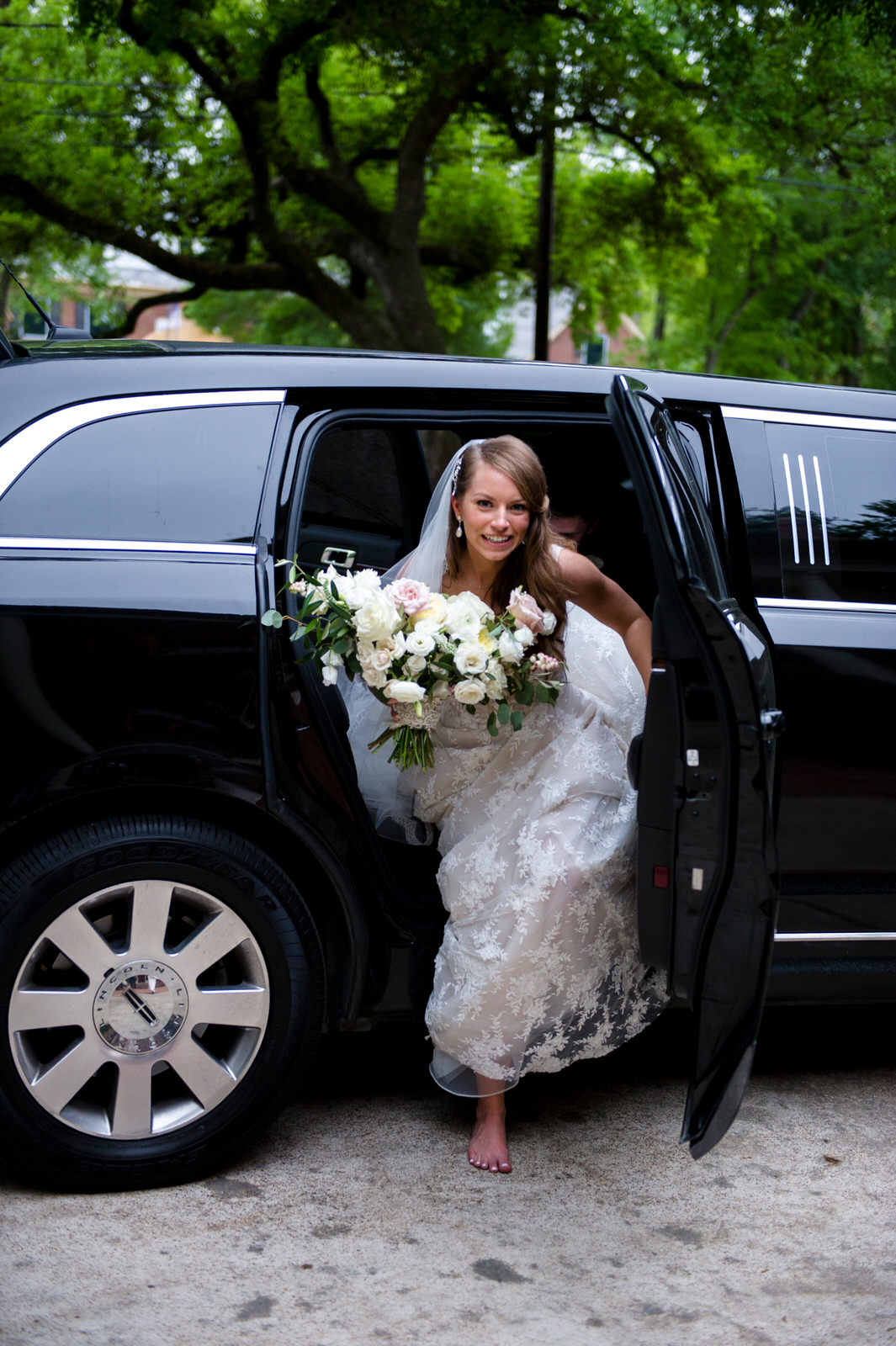 Bride with her bouquet stepping out limo to the reception. Houston, Texas. Maxit Flower Design,  Alyssa Meeks  ,  Chris Bailey Photography