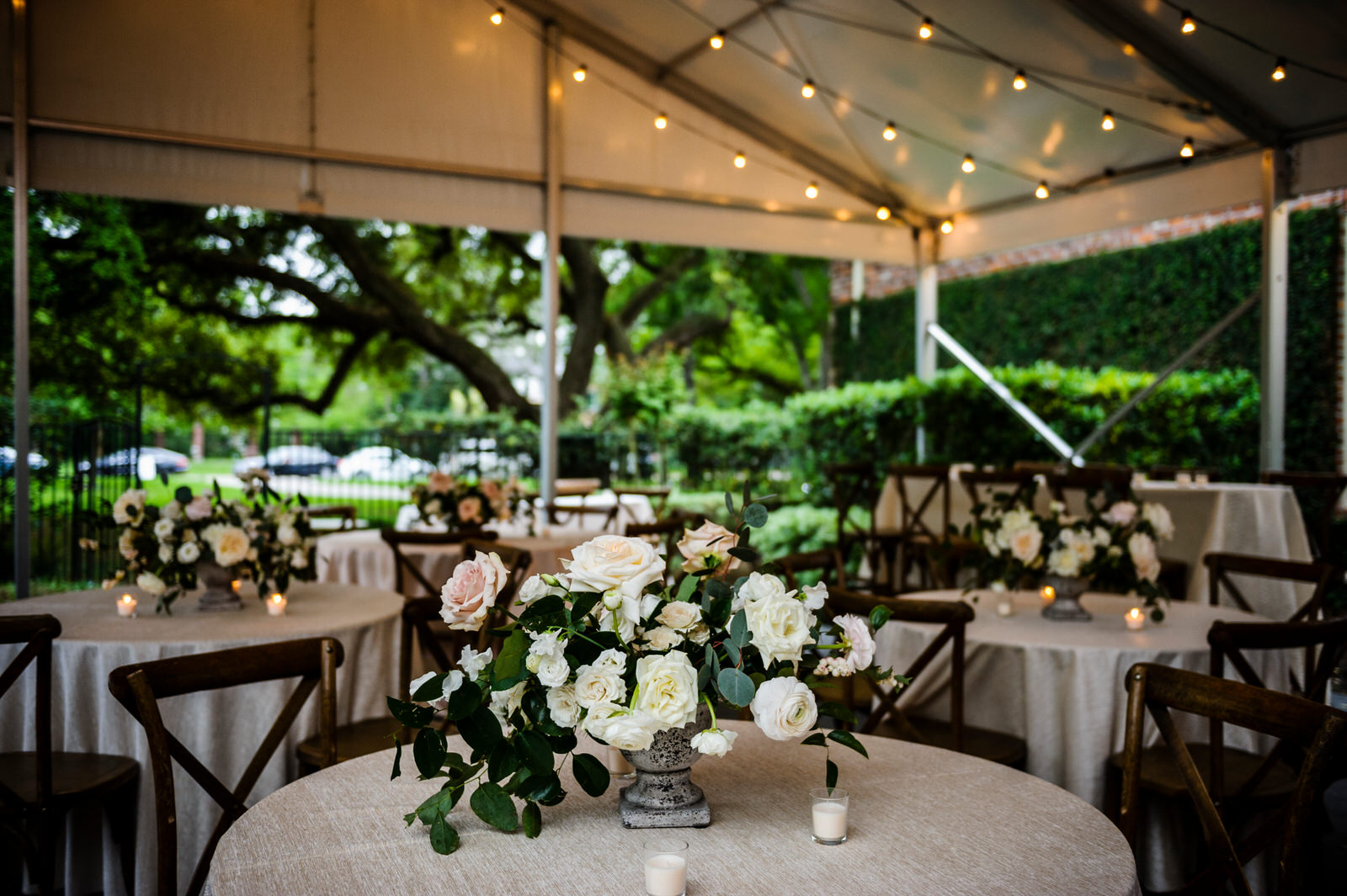 Garden style centerpiece with all white and touches of blush flowers. Houston, Texas. Maxit Flower Design,  Alyssa Meeks  ,  Chris Bailey Photography