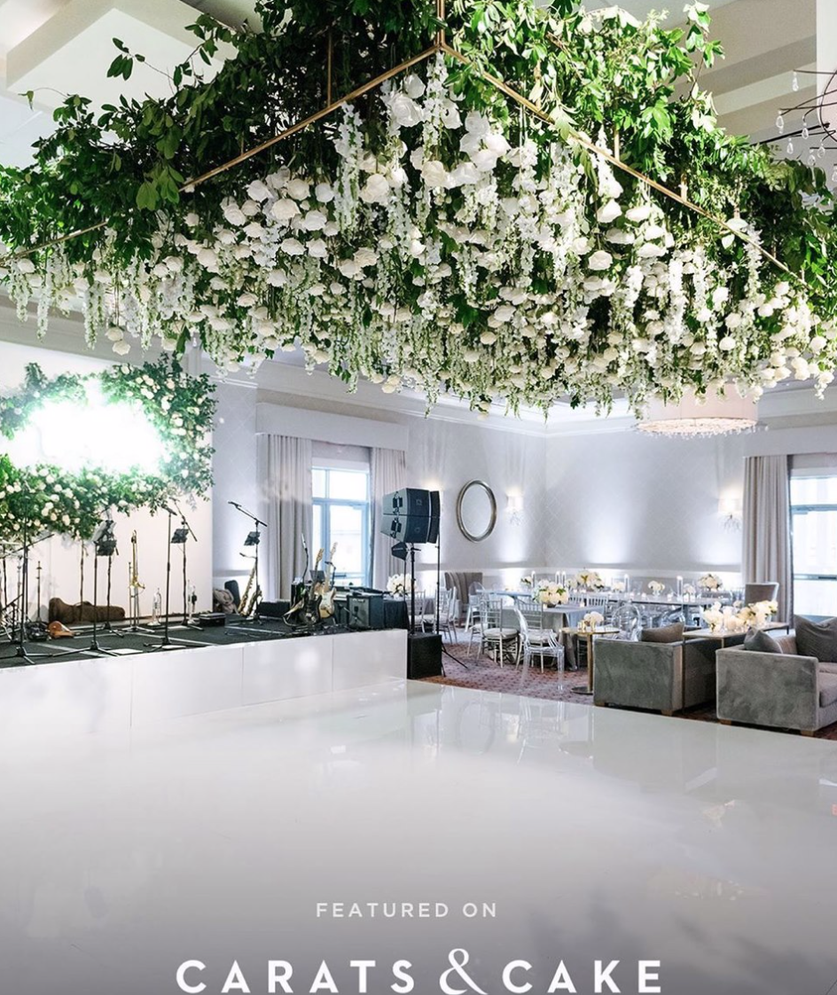Large flower installation hanging over dance floor.  White dance floor with band backdrop with neon sign. Photography:  Josh & Dana Fernandez , Event Design & Floral:  Maxit Flower Design , Event Planner: Emily Moise,  Keely Thorne Events