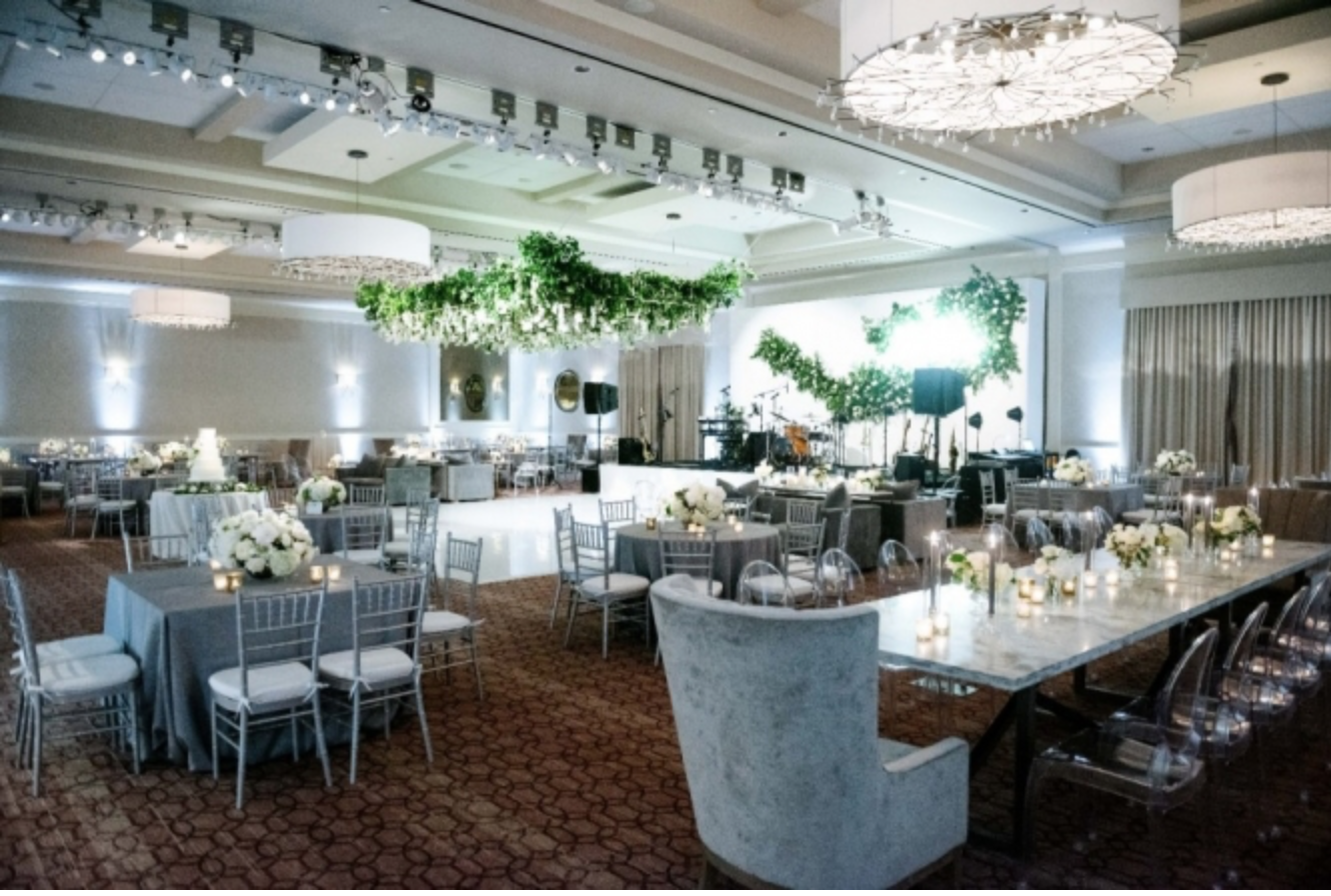 Event design with all white florals and gray accenting furniture. Photography:  Josh & Dana Fernandez , Event Design & Floral:  Maxit Flower Design , Event Planner: Emily Moise,  Keely Thorne Events