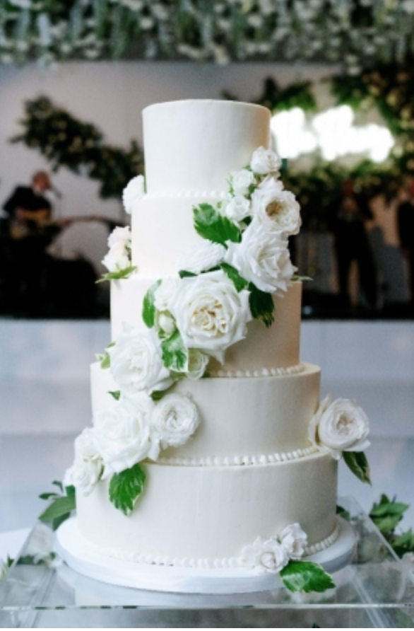 Cake flowers with all white and green florals. Photography:  Josh & Dana Fernandez , Event Design & Floral:  Maxit Flower Design , Event Planner: Emily Moise,  Keely Thorne Events