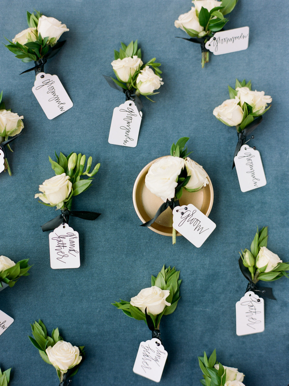Styling of groom and groomsmen boutonniere's. Styling & Photography:  Josh & Dana Fernandez , Event Design & Floral:  Maxit Flower Design , Event Planner: Emily Moise,  Keely Thorne Events