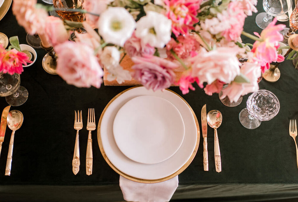 Dark green linen with gold charger, white plates, gold silverware and pink water glass. Houston, TX Wedding and Event Flower and Event Designer. Maxit Flower Design, Event Planner:  Unveiled Bridal,  Retnals:  Archive , Linen:  EBInc.