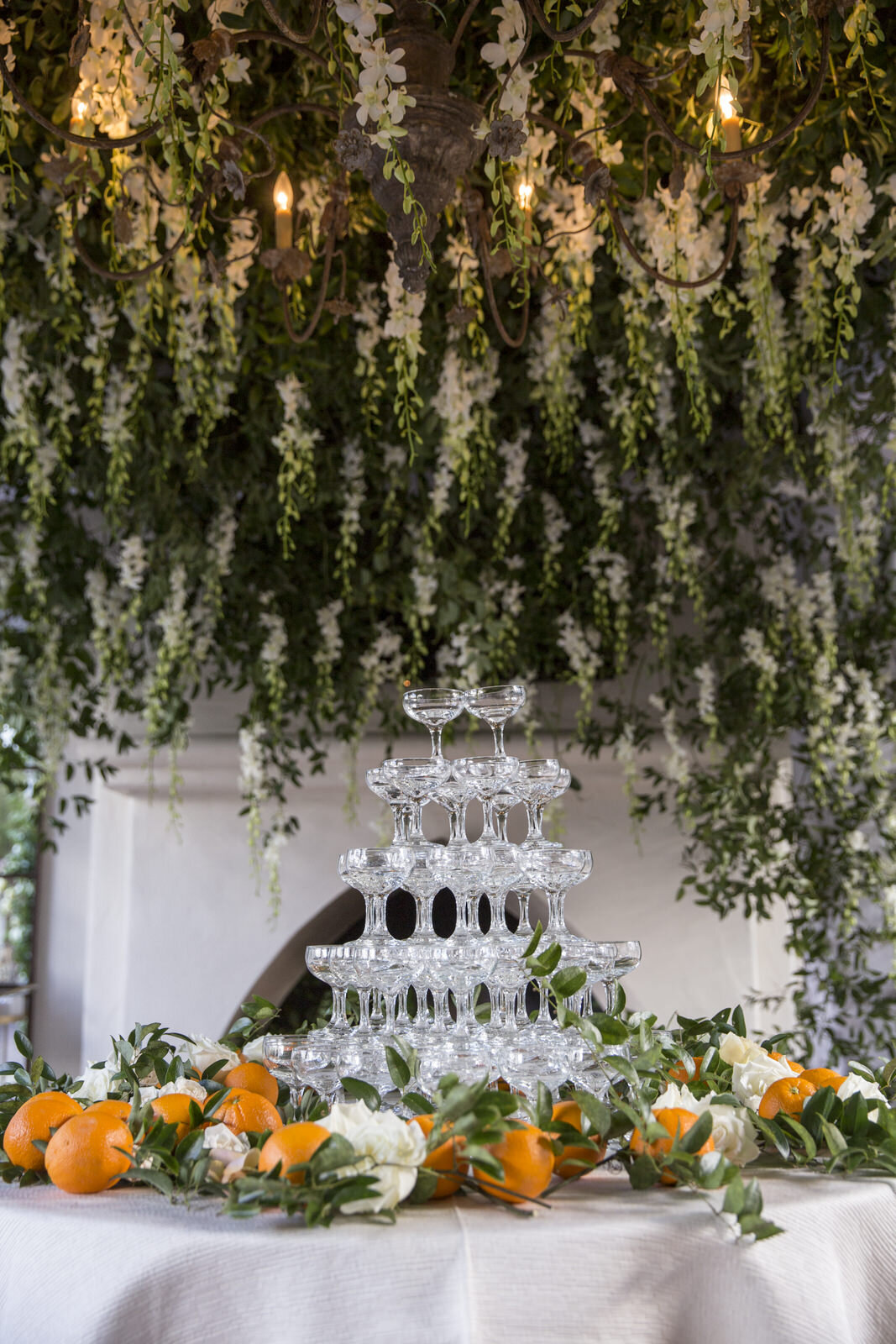 Orchid installation with oranges and styled blooms for the champagne presentation. Houston, Texas wedding with Jennifer Kaldis of Keely Thorne Events. Maxit Flower Design.