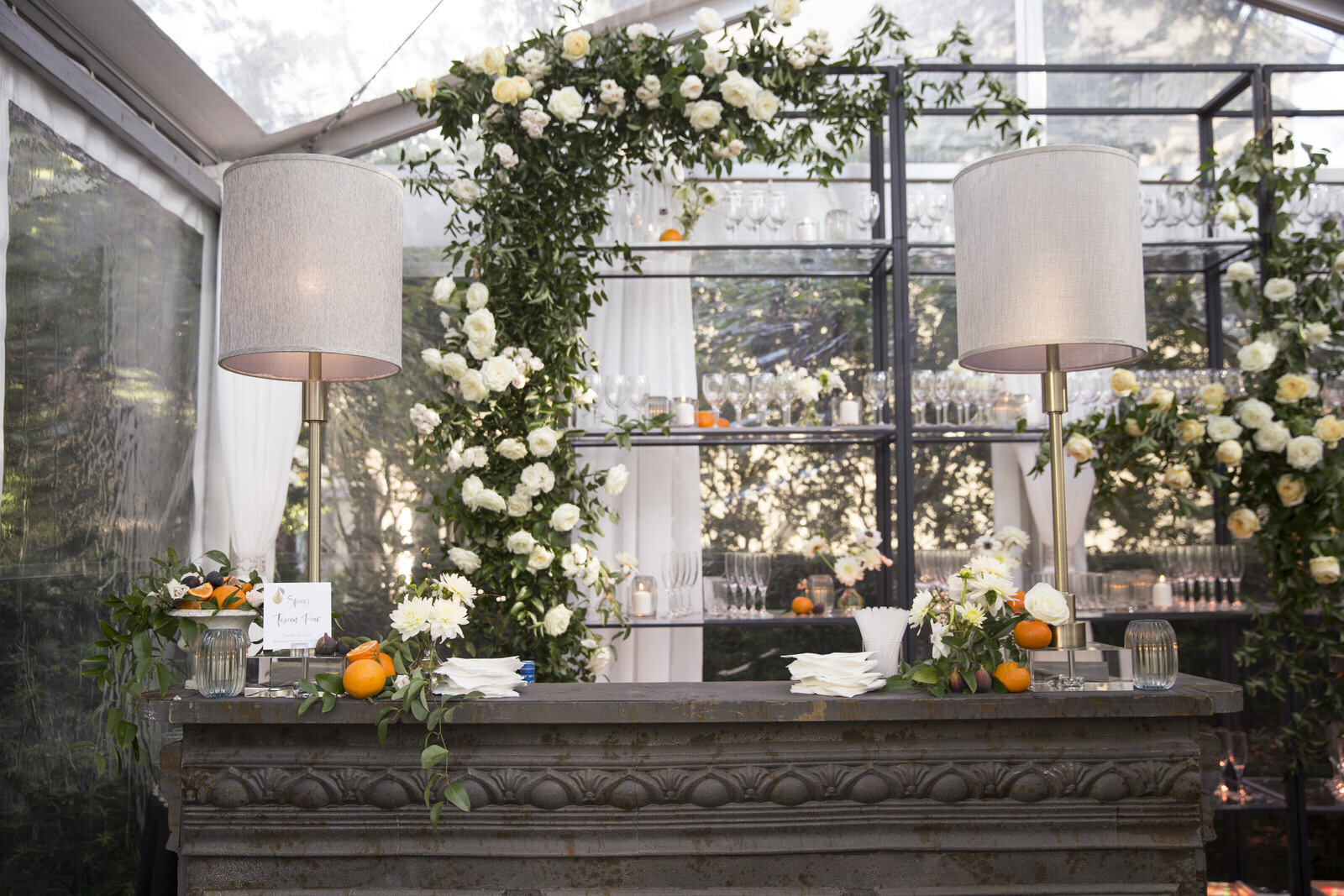 Floral installation on bar back with styled fruit and florals through out the bar.  Rentals provided by Events in Bloom. Houston, Texas wedding with Jennifer Kaldis of Keely Thorne Events. Maxit Flower Design.