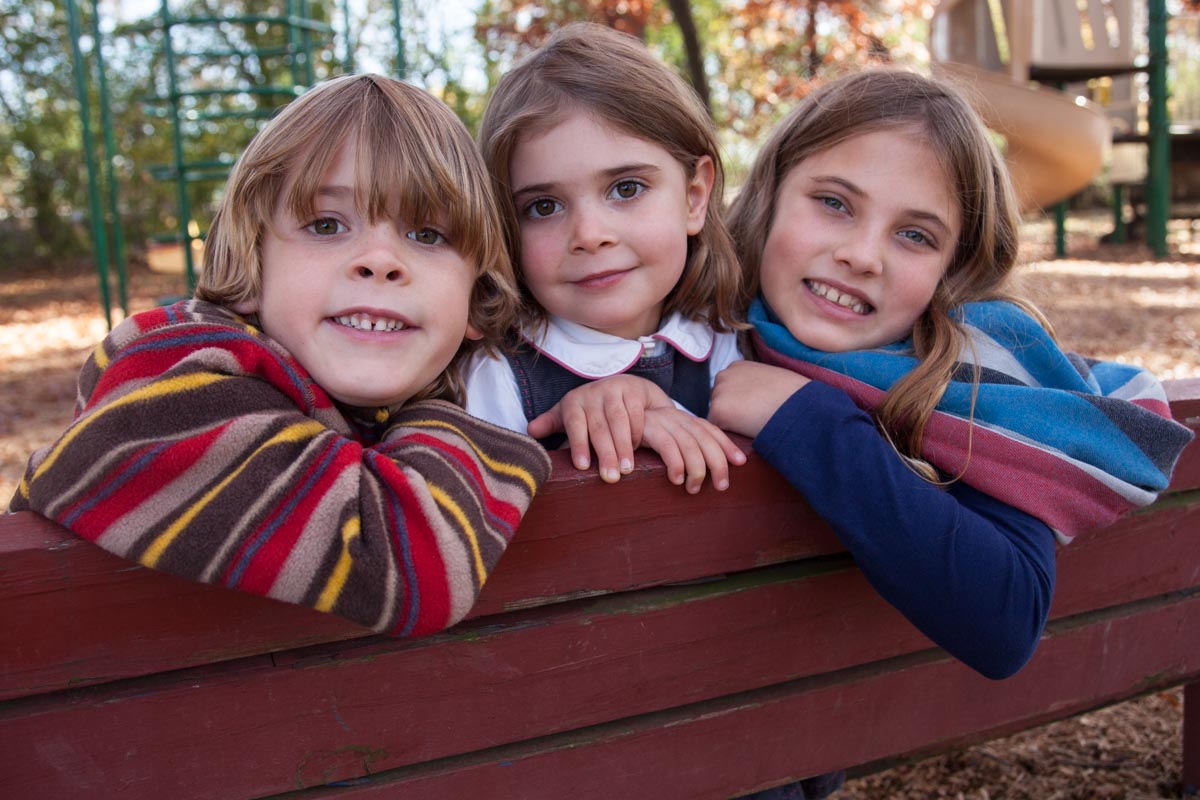 Photograph of brother and sisters by Madison WI photographer Nick Wilkes