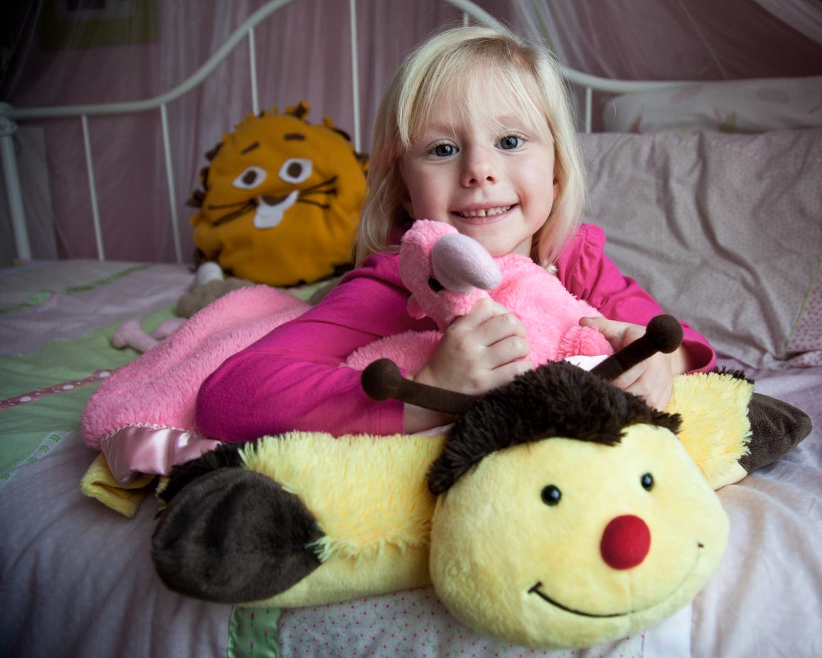 Portrait of a child with stuffed animals by Madison WI photographer Nick Wilkes