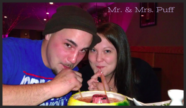 What a cute couple! I bet they're a riot to party with! They sure do look like a happy stoner couple! I love this picture! I like how they're smiling with straws in their mouths. Talent! That looks like one hell of a drink, it almost looks like a small fountain. Cool.