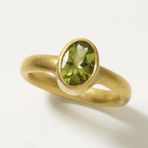 Dianna Ring    The simple domed band highlights the beauty of any stone. Shown here with a Peridot.