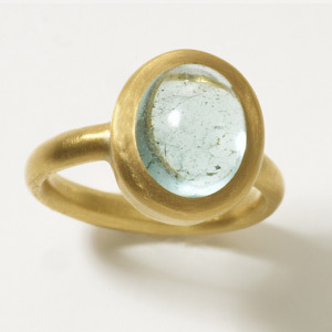 Isis Ring   This domed band setting with a hammered down bezel will highlight the beauty of any stone. Set with a beautiful sea water blue