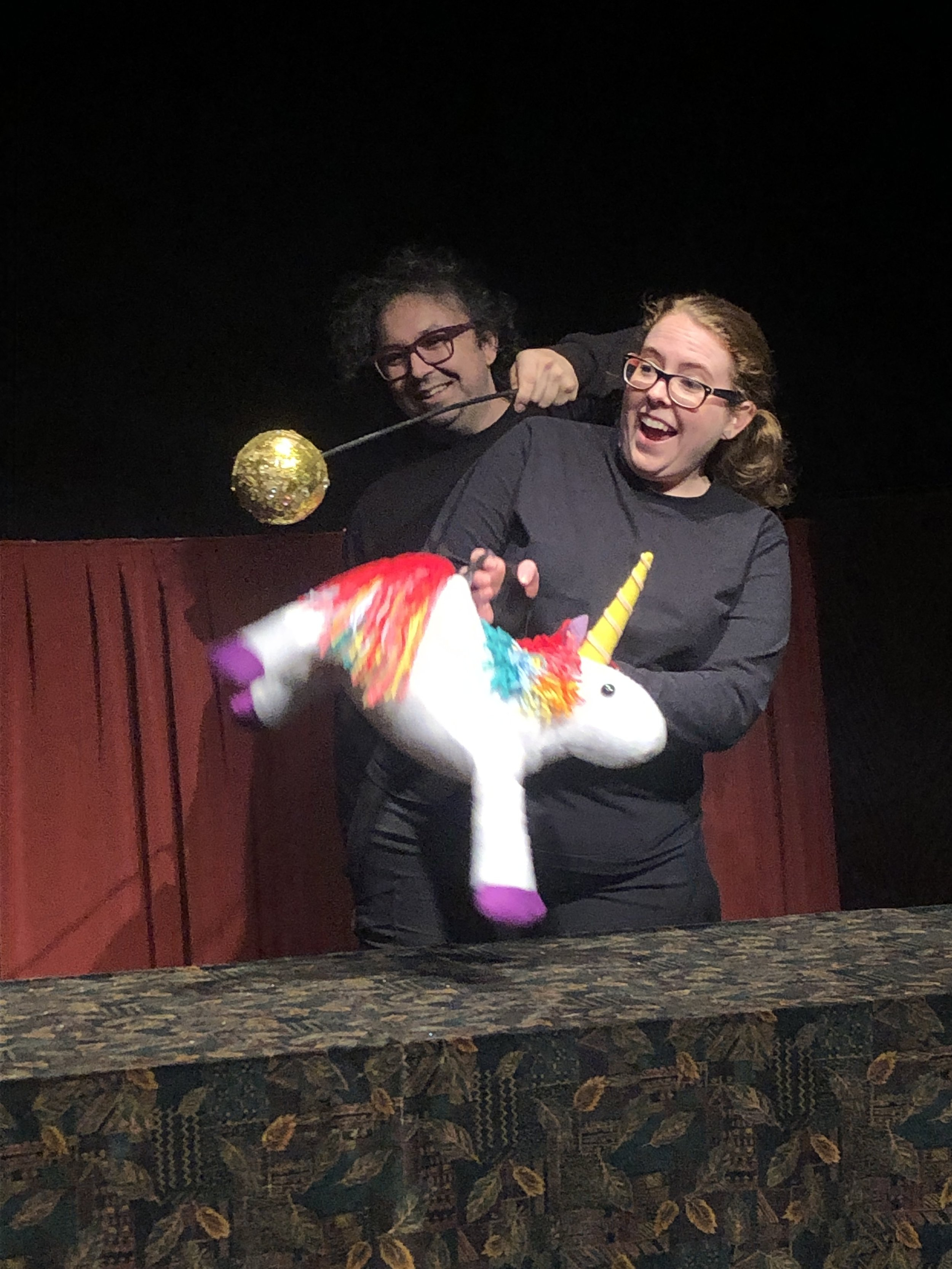 the unicorn in action with puppeteers gwen bonar and gavin cummins.