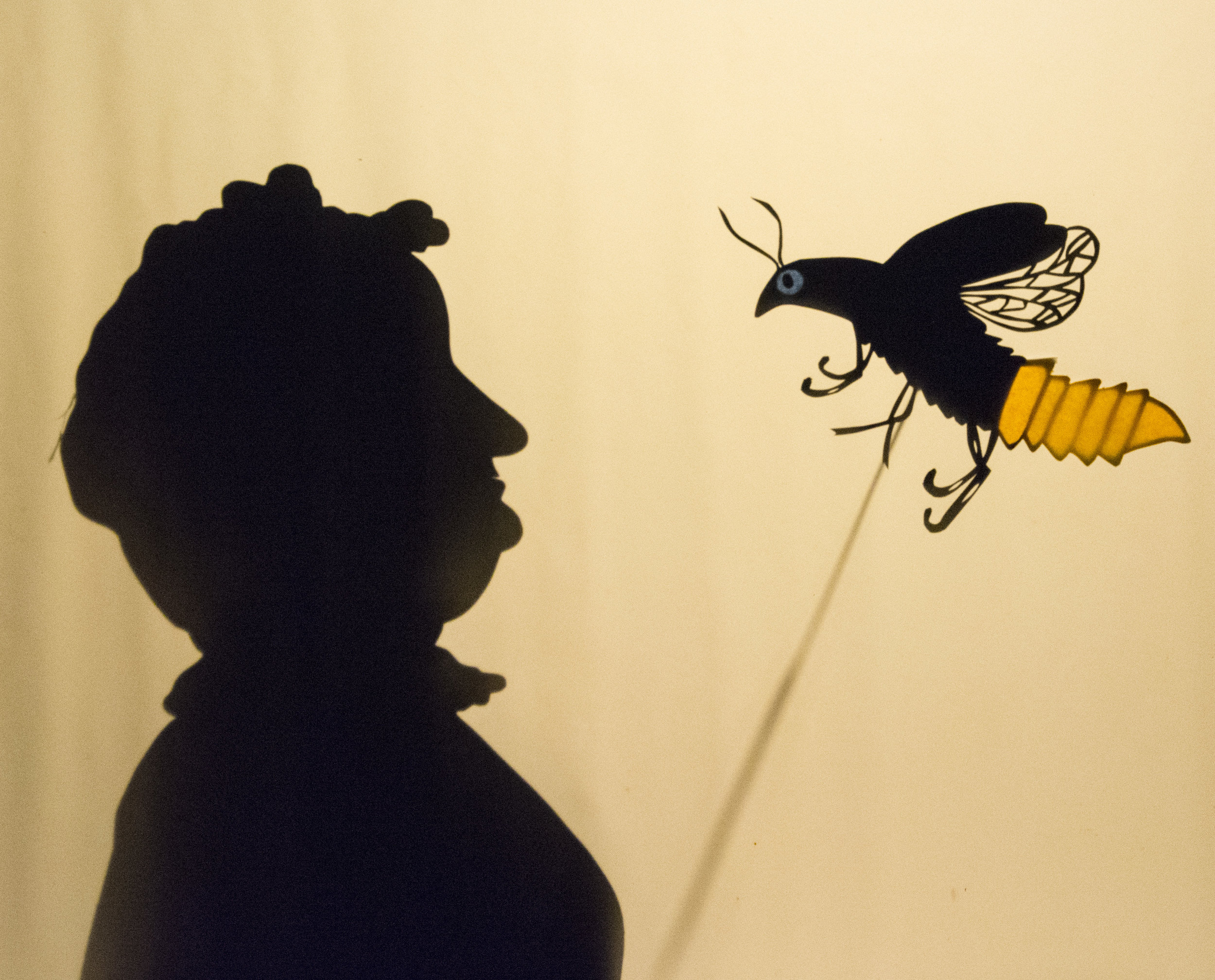 "firefly & old woman shadow puppets created for the story ""how the firefly got its glow"" by juday'ah gore, 3rd grade"