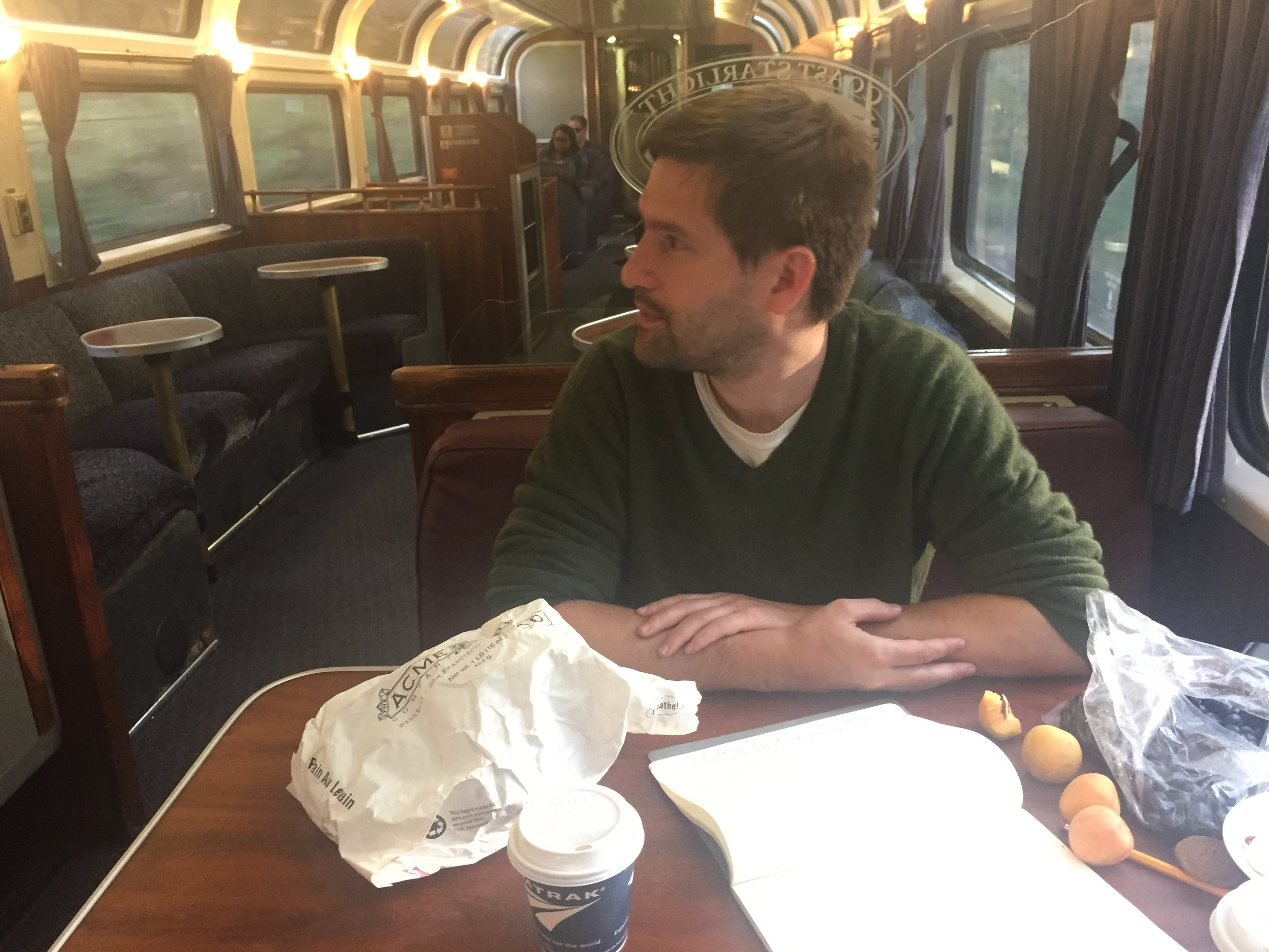Here we are in the Amtrak parlor car, drinking FREE coffee (see below) and eating blueberries and apricots and crusty bread we brought from home.
