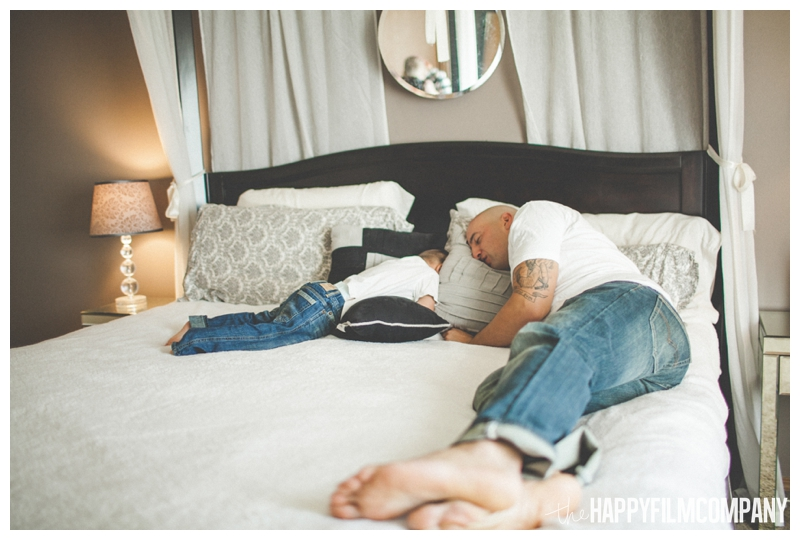 father son photos lying on bed  - Natural Seattle Newborn Photography - the Happy Film Company