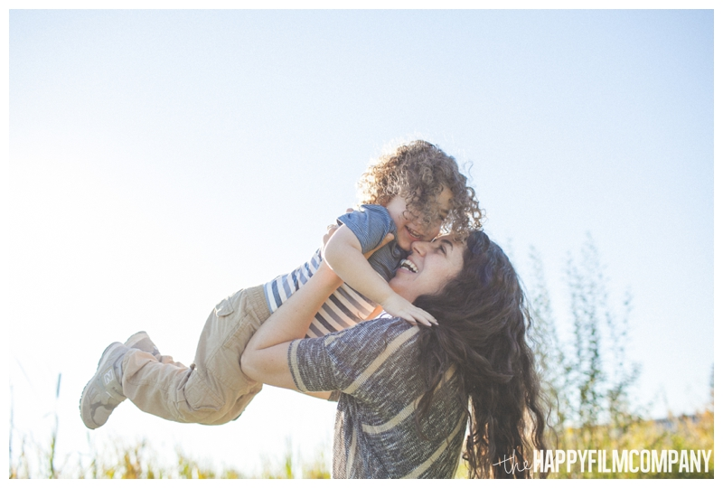 mother son photos throwing kids in the air  - Seattle Family Apple Picking Photo Shoot - the Happy Film Company