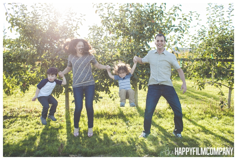 family jumping golden hour  - Seattle Family Apple Picking Photo Shoot - the Happy Film Company