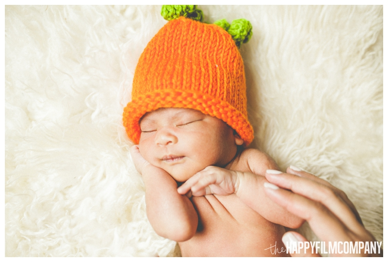 baby in pumpkin hat newborn photography  - the Happy Film Company - Seattle Newborn Photos at Home