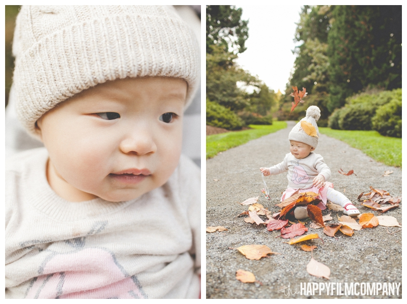 baby playing in leaves  - Colorful Leaves Seattle Autumn Family Photos at Washington Park Arboretum - the Happy Film Company