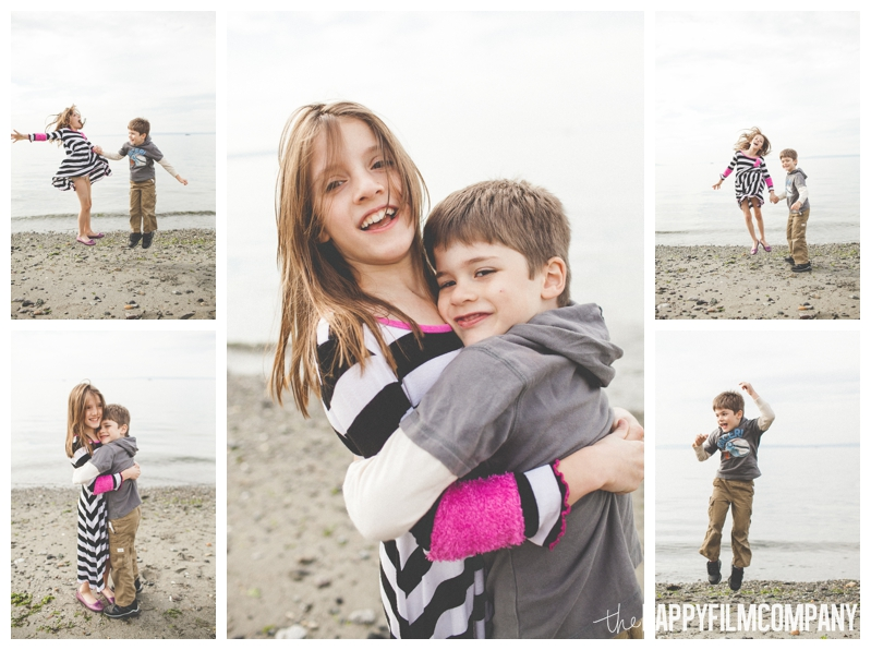 siblings playing on the beach jumping  – Playful Golden Gardens Beach Walk — Seattle Family Holiday Pictures