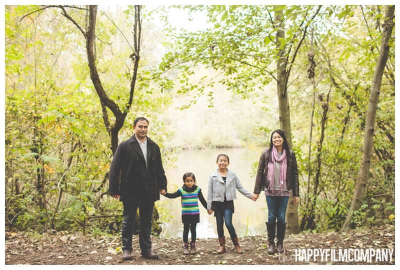 family holding hands in line — Seattle Family Photos - Black River Riparian Forest and Wetland - the Happy Film Company