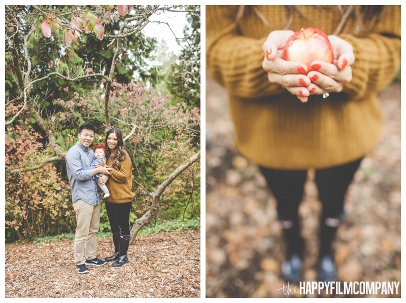 autumn holding apple in hands orange sweater  - Seattle Family Holiday Portraits - the Happy Film Company