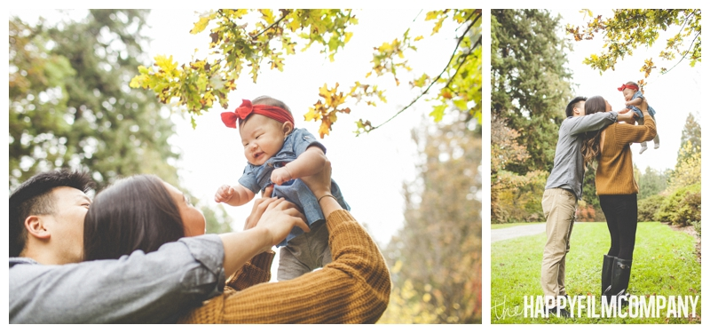throwing baby into the air autumn pictures   - Seattle Family Holiday Portraits - the Happy Film Company