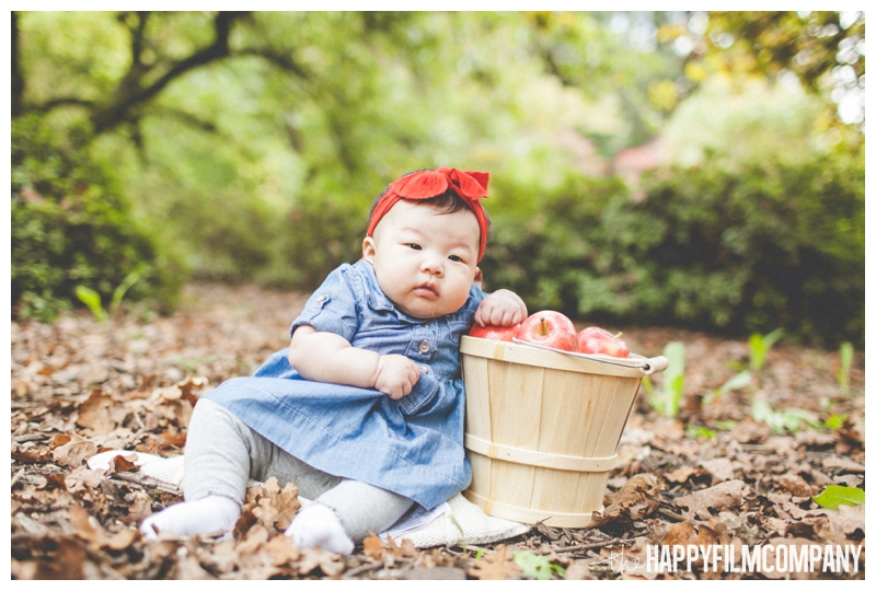 little girl with apple basket   - Seattle Family Holiday Portraits - the Happy Film Company